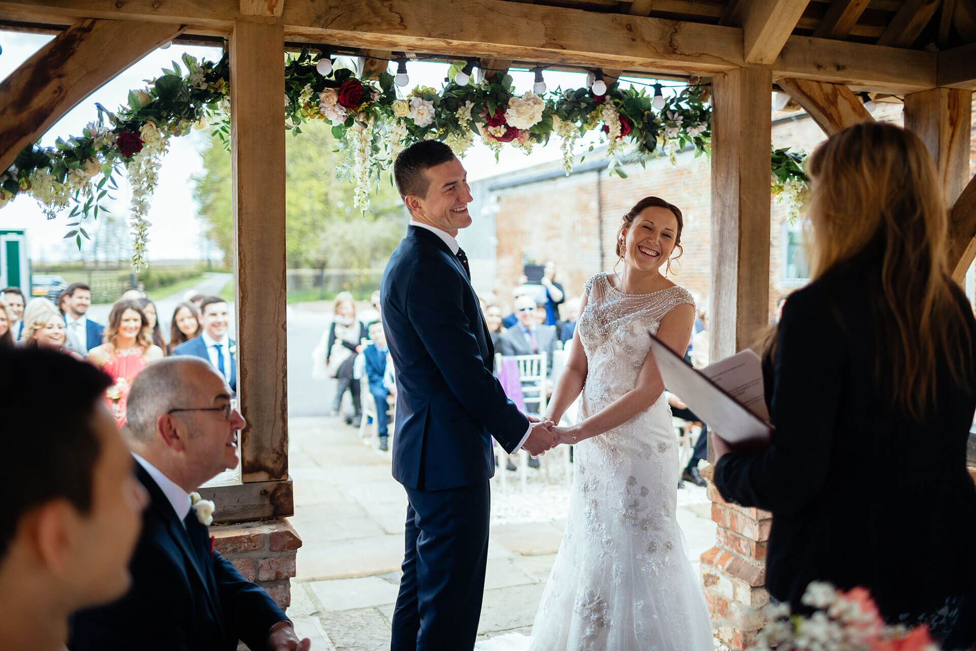 "The sun was shining on the lovely Amy and James for their ceremony under the Lych Gate. Photography courtesy of <a href=""http://www.joestenson.co.uk/"">Joe Stenson</a>."