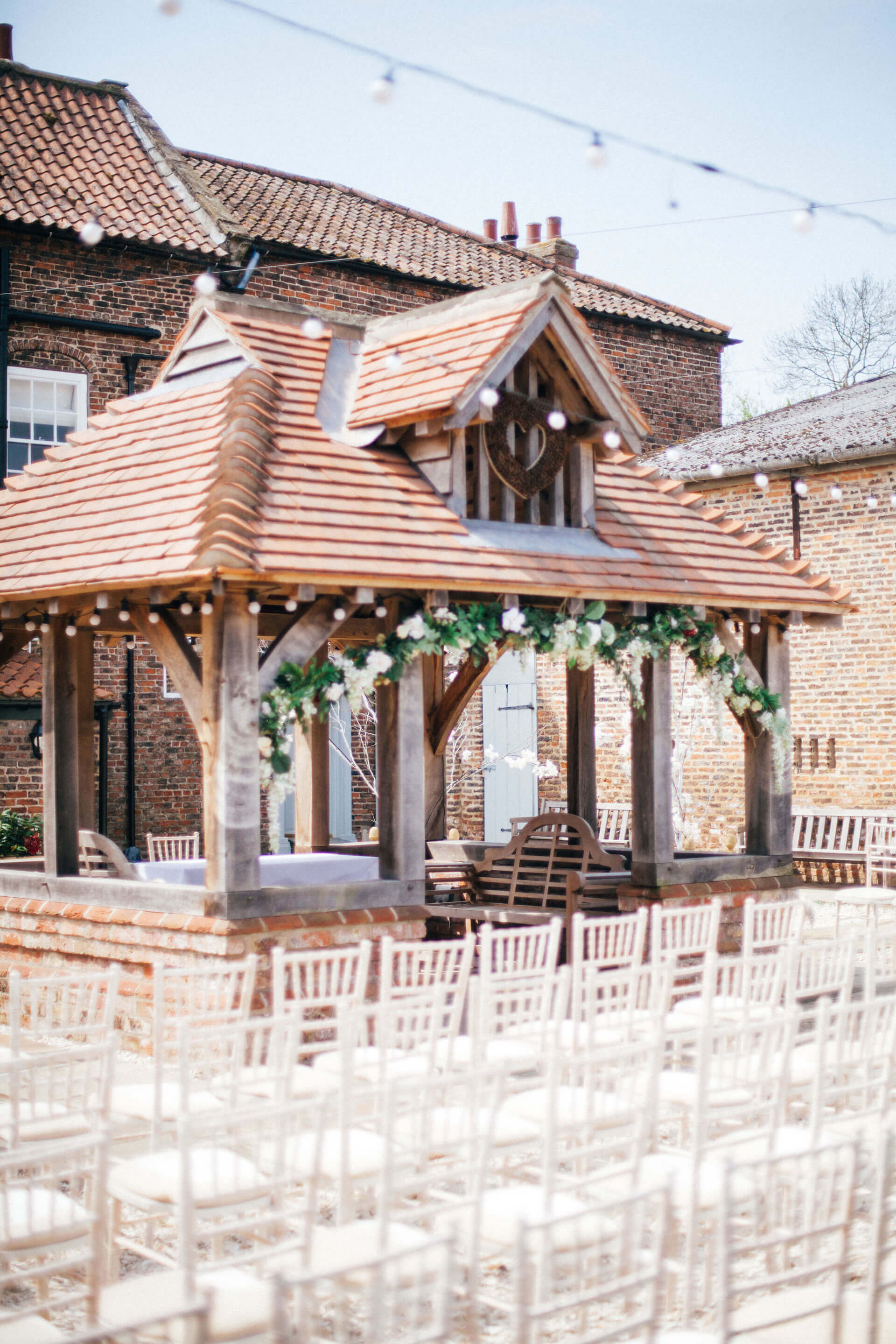 "We will never forget Angela and Toby's beautiful ceremony held underneath the Lych Gate. Photography courtesy of <a href=""http://www.leahhensonweddings.com/"" target=""_blank"">Leah Henson</a>."
