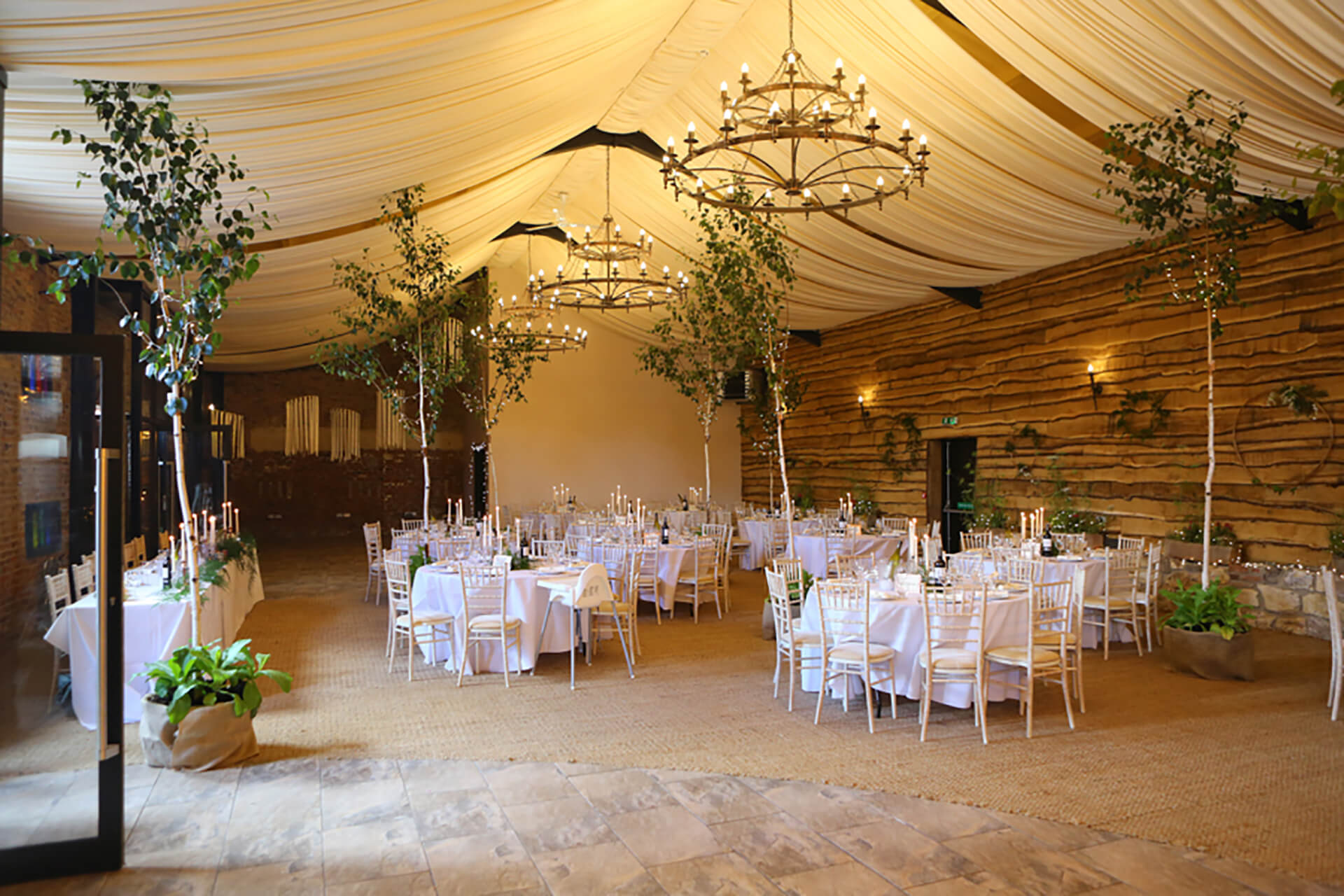 Why not bring the outside in? Beautiful trees at Katie and Andrew's wedding. Image by Simon Stock.
