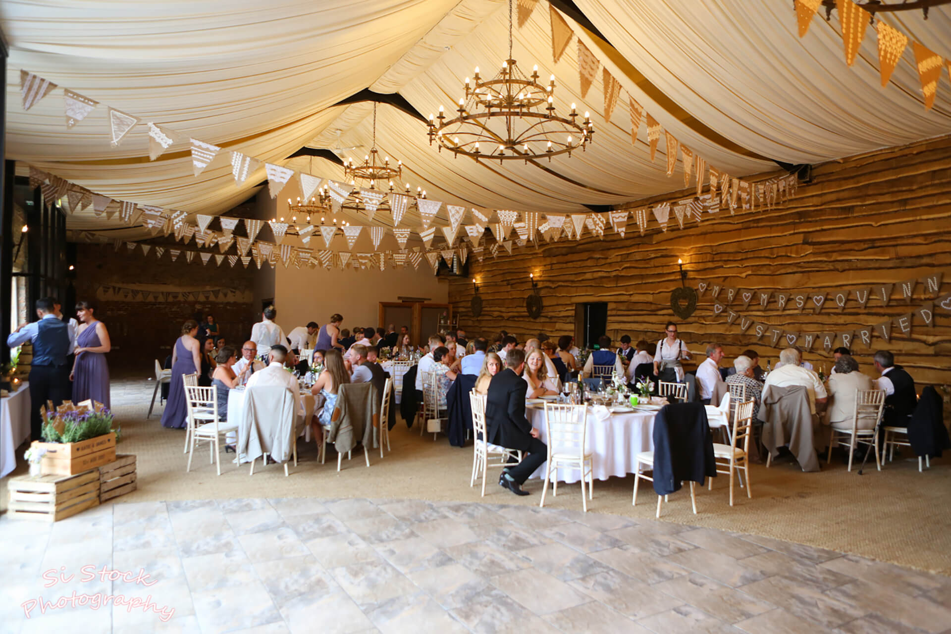 Rustic bunting at Katie and James' wedding. Shot by Simon Stock.