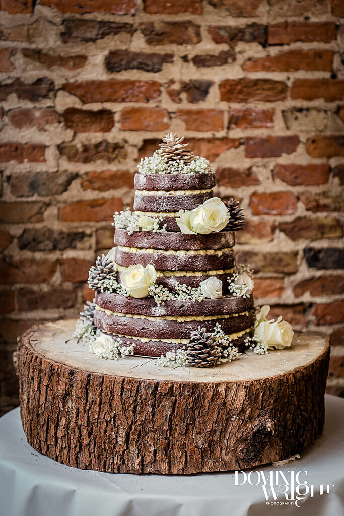 "What a stunning cake at Lucy & Raife's wedding. Photography by <a href=""http://dominicwright.co.uk/"" target=""_blank"">Dominic Wright</a>."