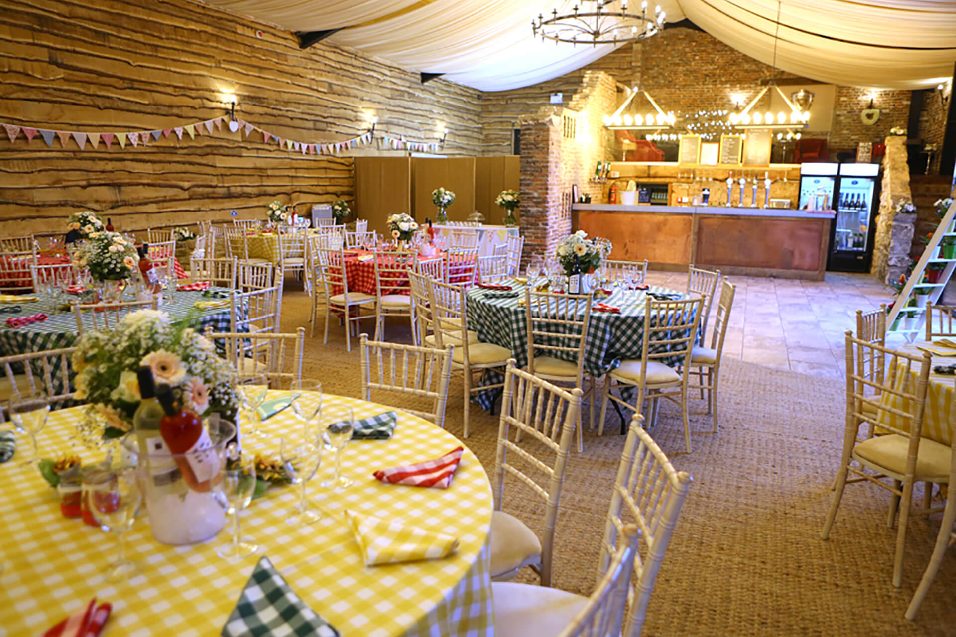 Marianna and Paul bringing Gingham chic to the wedding barn. Photo by Simon Stock.