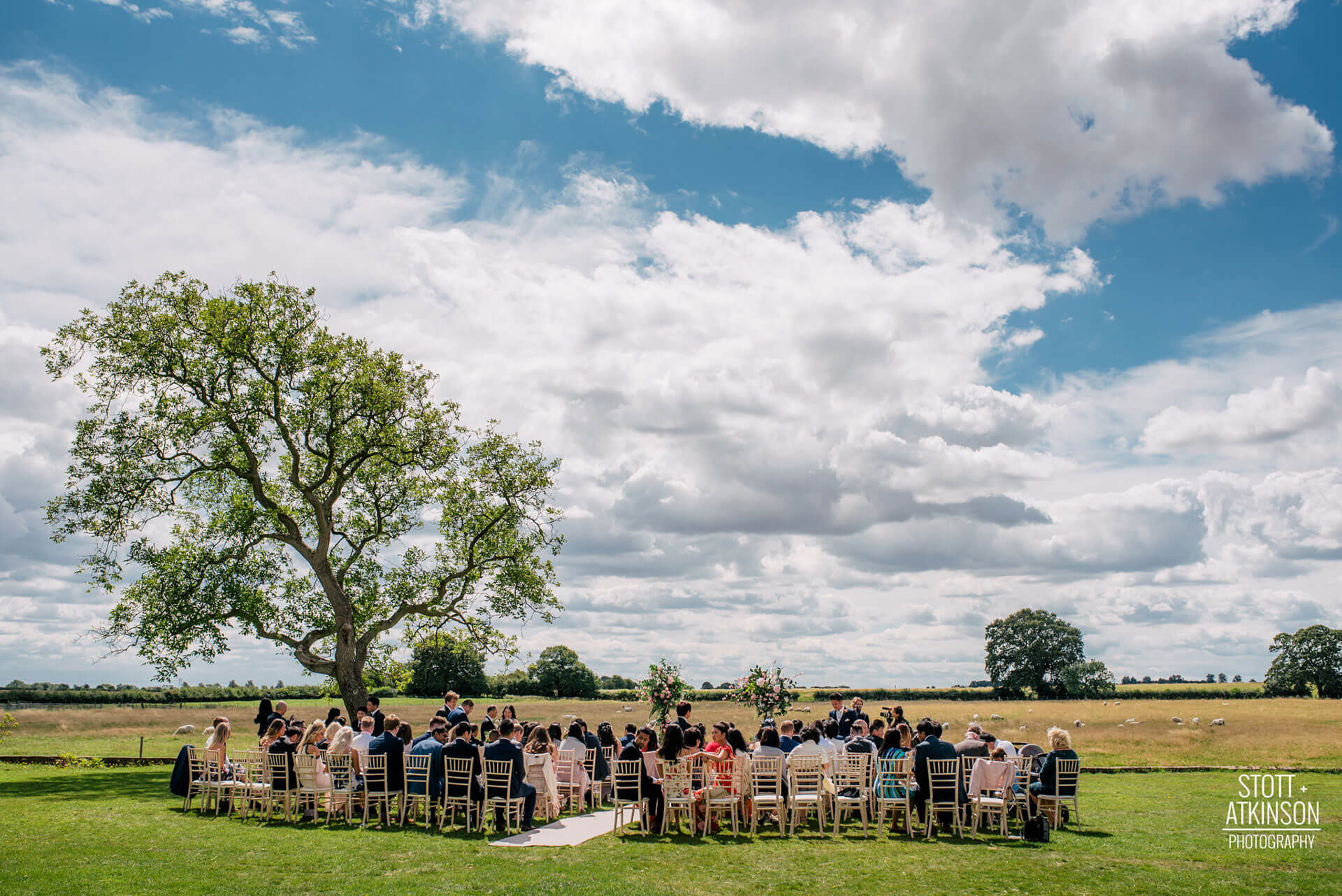 "Christine and Phil's ceremony on the Manor Lawn, overlooking the grazing sheep. Photography by <a href=""http://www.stottandatkinson.com/"" target=""_blank"">Stott + Atkinson Photography</a>."