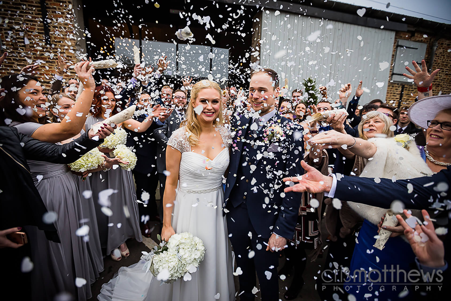 "Confetti showers for Joe and Laura! This perfect shot was captured by <a href=""http://www.crismatthews.com/"">Chris Matthews Photography</a>."