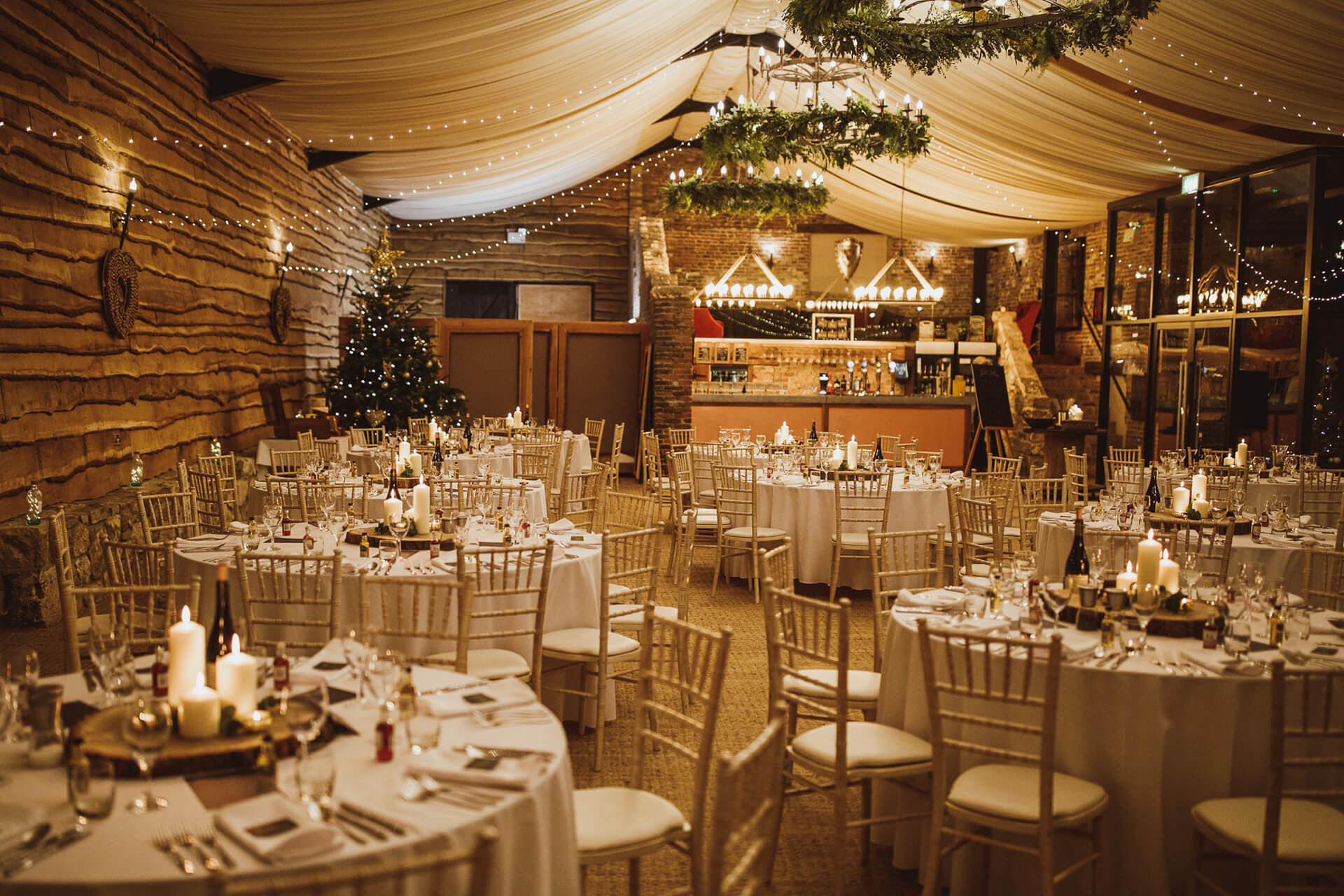 "Beautiful festive decoration at Sarah and Angus' winter wedding. Captured by <a href=""https://www.njphotographic.co.uk/"" target=""_blank"">Neil Jackson Photography</a>"