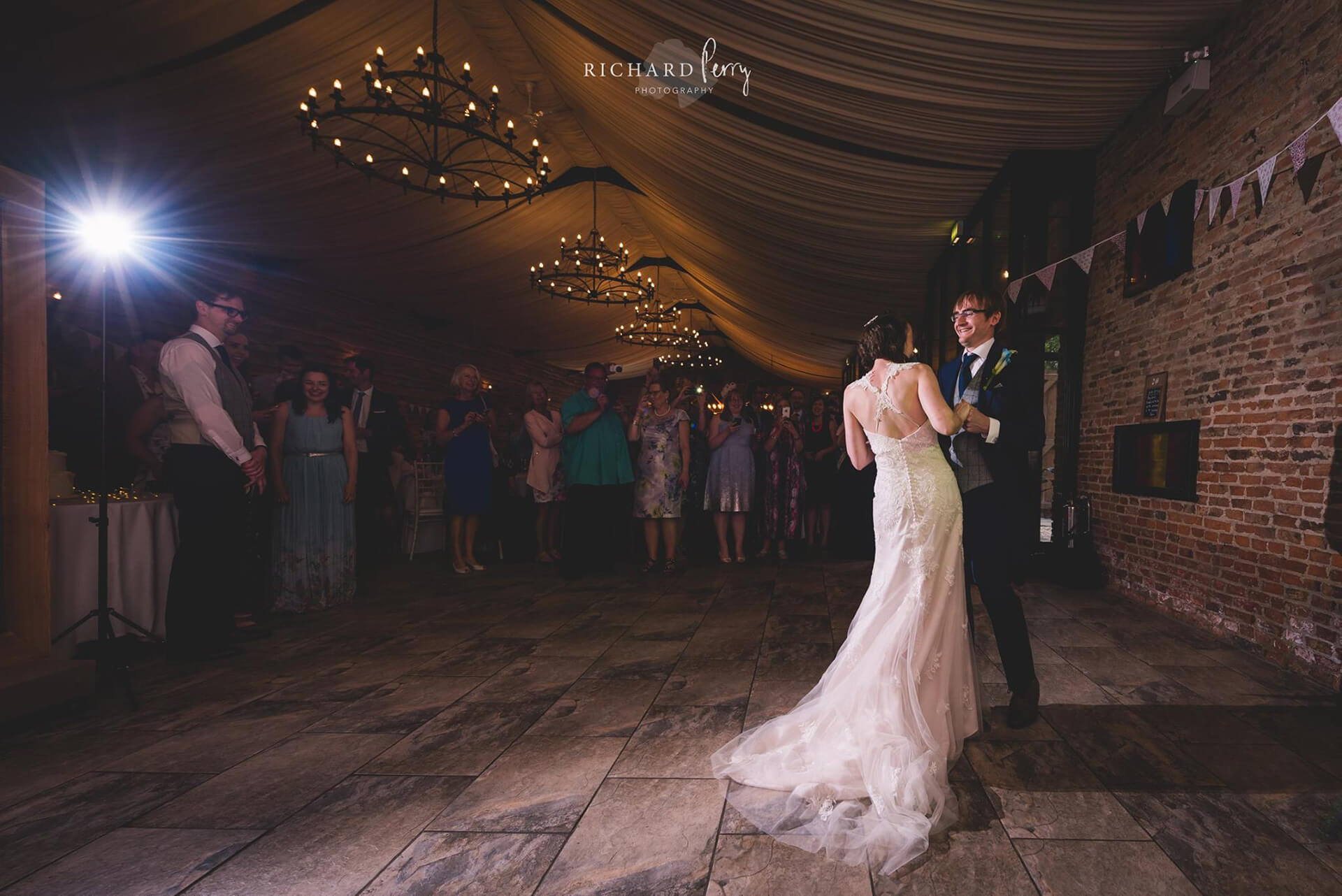 "<a href=""https://richardperryphotography.com/"" target=""_blank"">Richard Perry</a> captured this special moment between Sarah and Niel during their first dance."