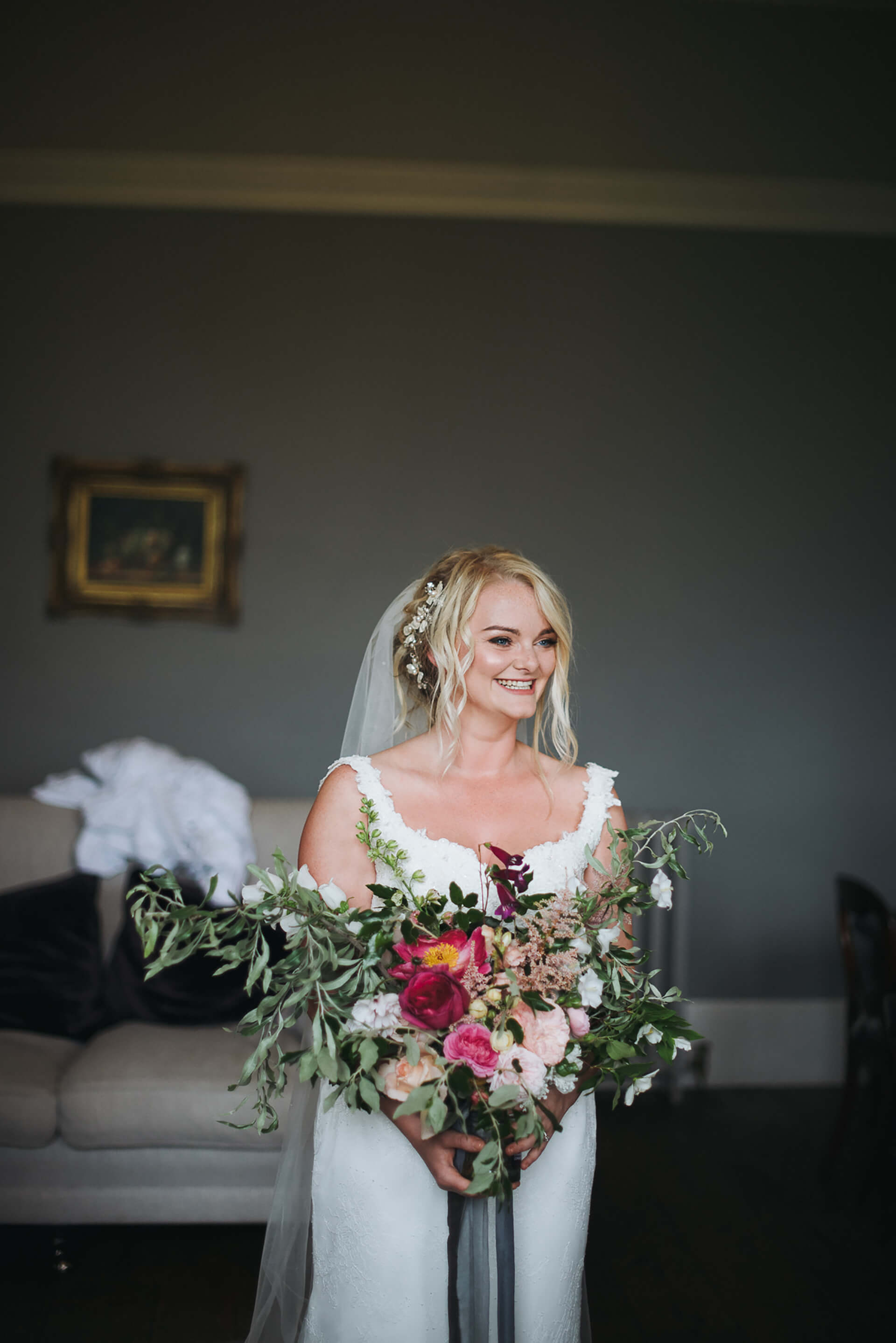 "Our gorgeous bride Kayleigh with her amazing bouquet! Photo by <a href=""http://www.alexandraholtphotography.com/"" target=""_blank"">Alexandra Holt</a>"