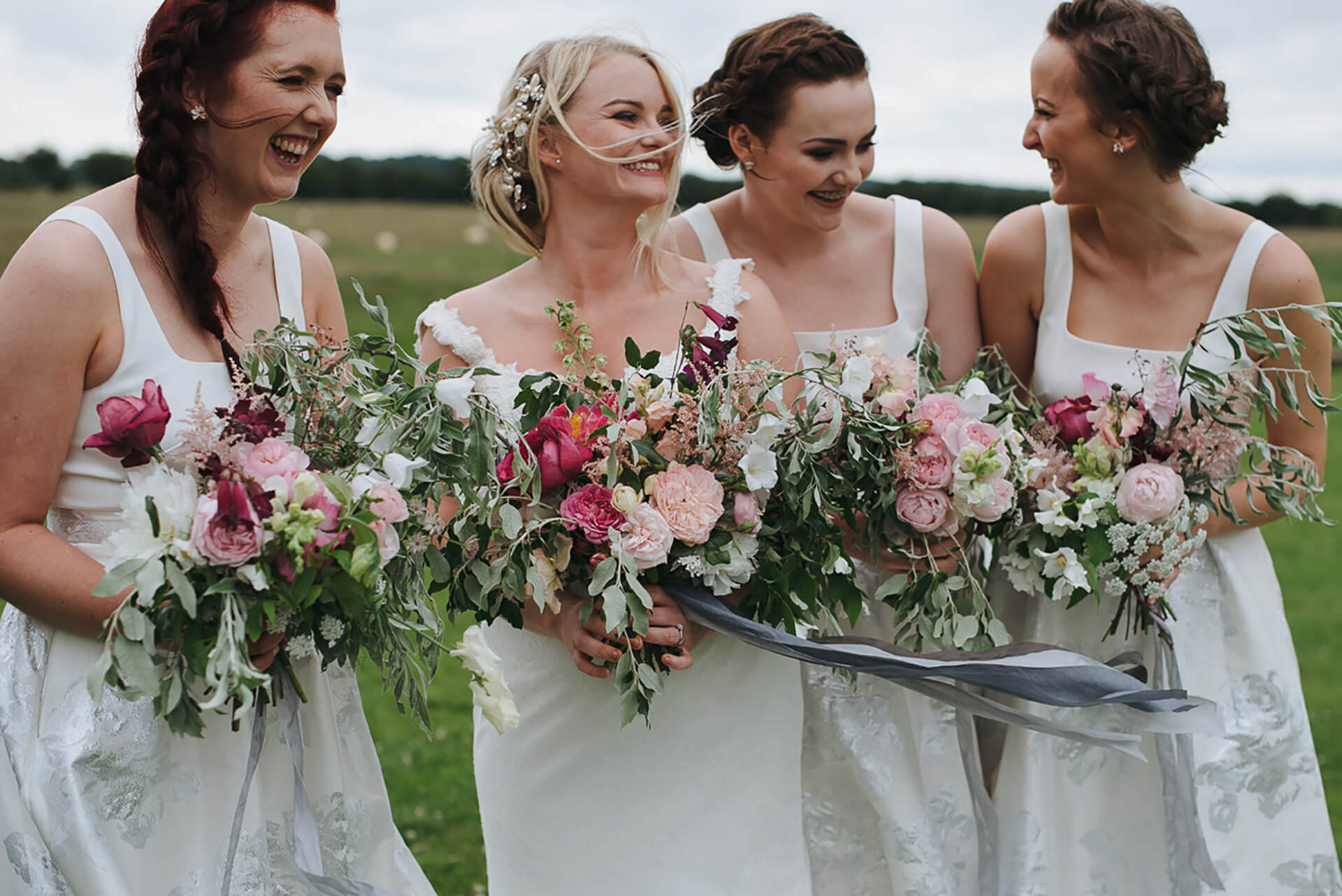 "We love this shot by <a href=""http://www.alexandraholtphotography.com/"" target=""_blank"">Alexandra Holt</a> of Kayleigh and her bridesmaids."