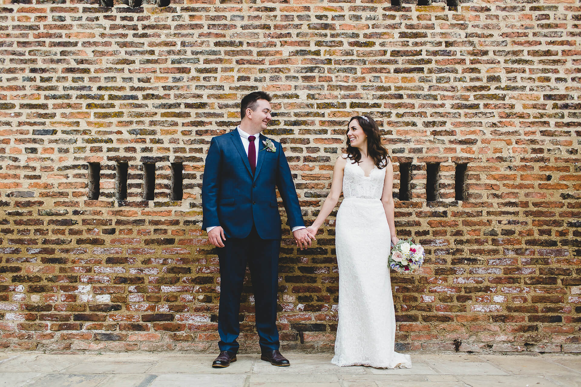 "We love how striking the Wedding Barn brick work is in this beautiful shot of Becky and James by <a href=""http://sarahbethphoto.co.uk/"" target=""_blank"">Sarah Beth</a>."