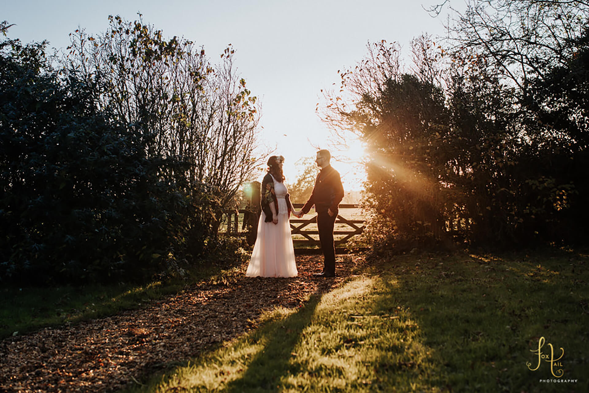 "Becky, Ben, and the setting sun. Captured by <a href=""http://foxtailphotography.co.uk/"" target=""_blank"">Fox Tail Photography</a>"