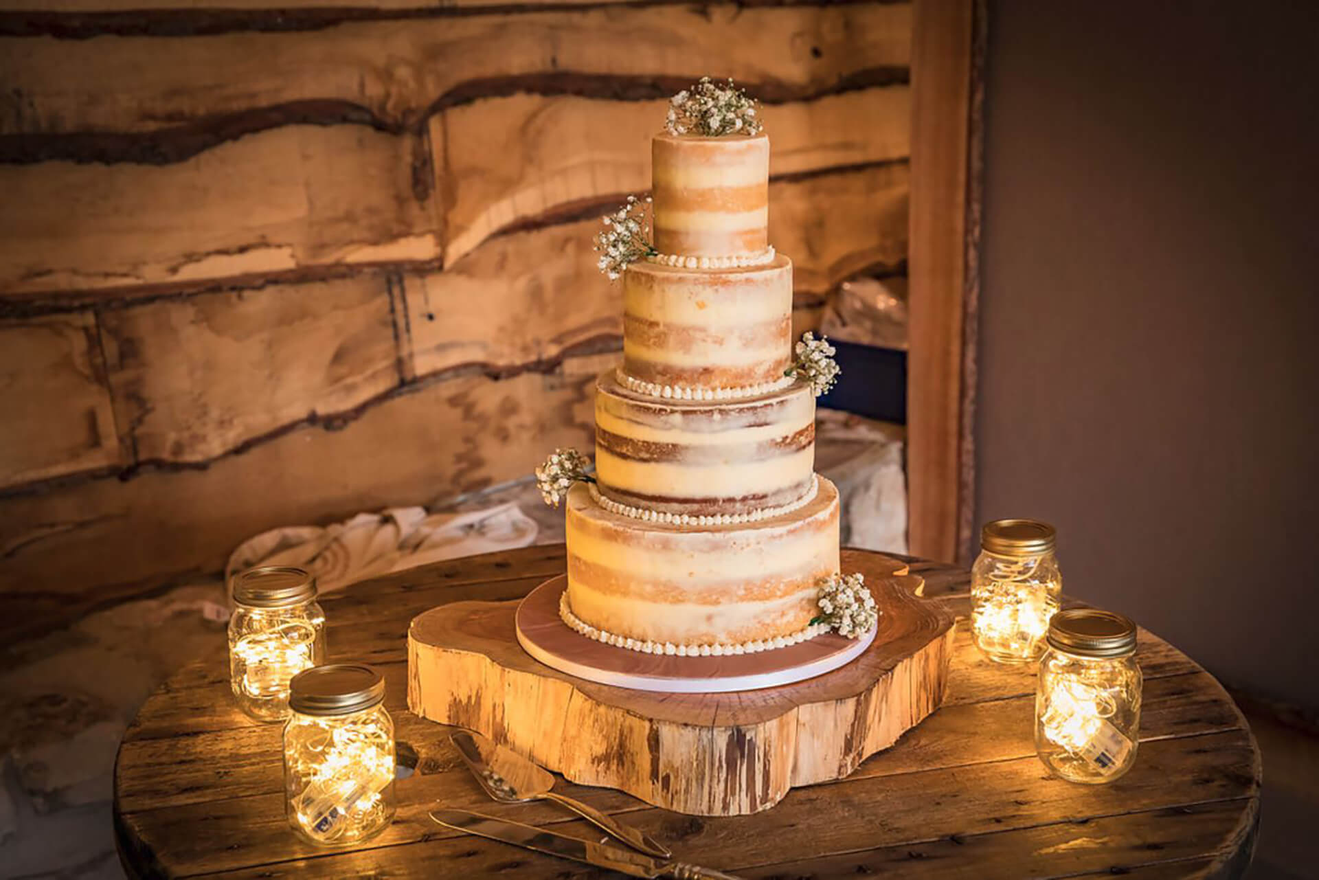 "Hannah and Mark's incredible cake captured by <a href=""http://www.chrisreidphotography.co.uk /"" target=""_blank"">Chris Reid</a>."