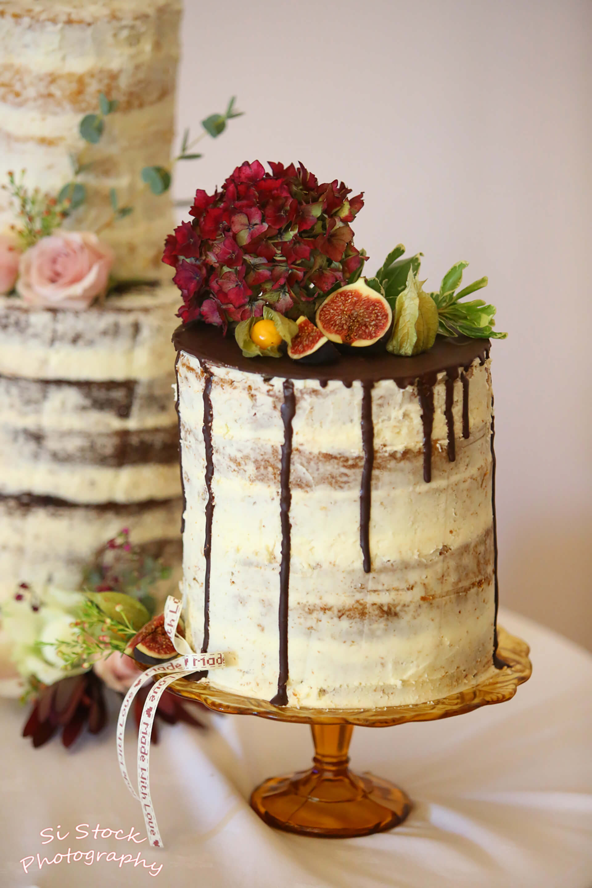 What a showstopper! Rosie and David's wedding cake captured by Simon Stock.