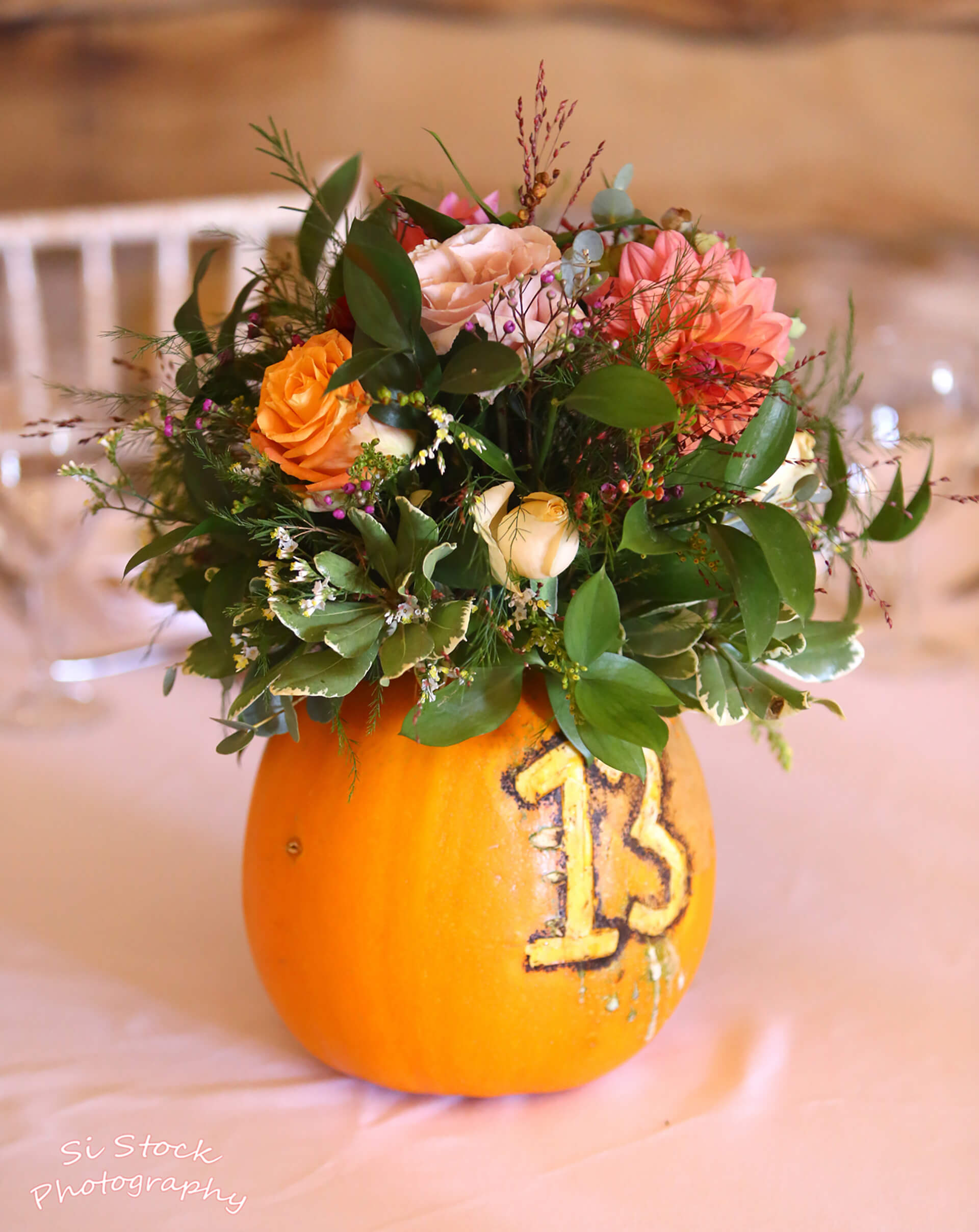 We love these pumpkin centrepieces at Roseanna and David's wedding, curtesy of Rosie Buffery Foliage and Floristry.  Captured by Simon Stock.