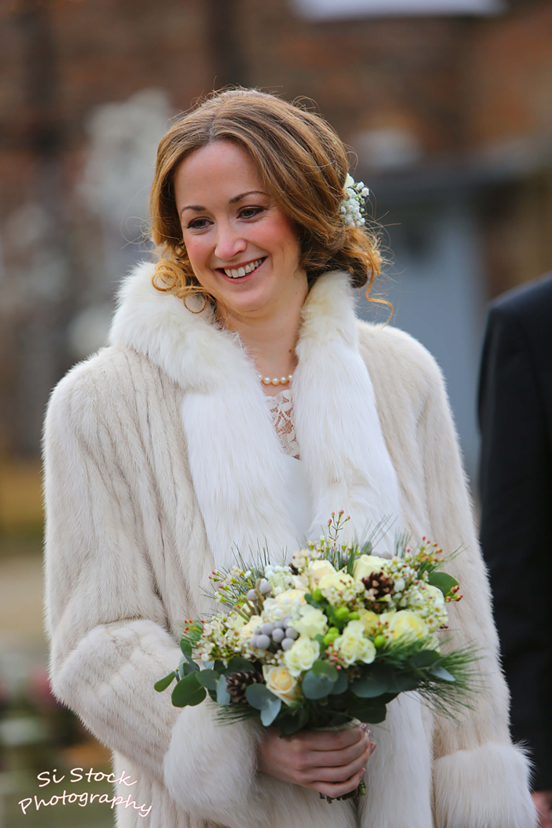 Our beautiful bride Holly, wrapped up for her winter wedding.