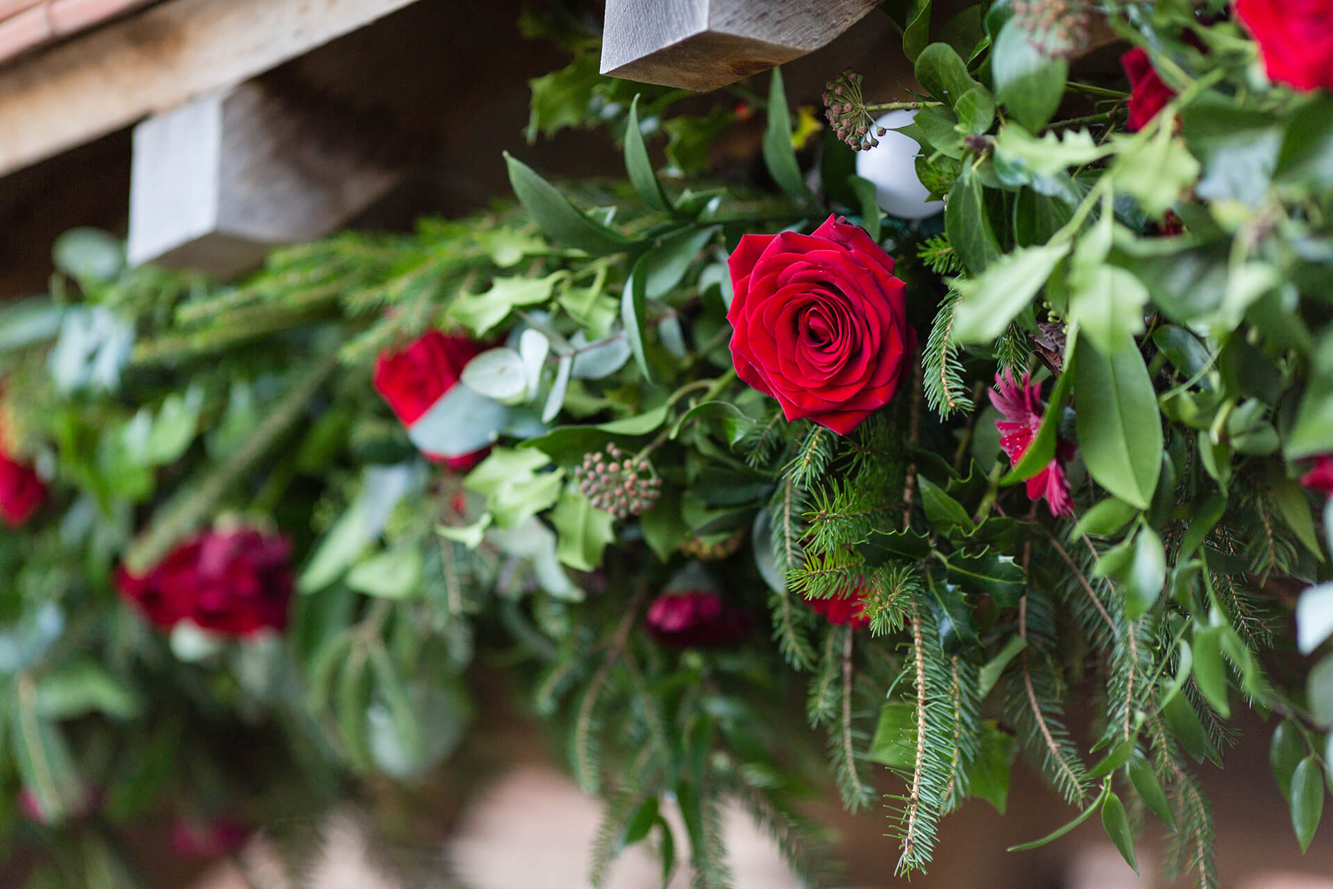 "A festive Lych Gate decorated by the talented <a href=""http://wildfloralcouture.co.uk/"" target=""_blank"">Wild Floral Couture</a>. Photography by <a href=""http://www.tuxandtalesphoto.co.uk/"" target=""_blank"">Tux and Tales</a>."