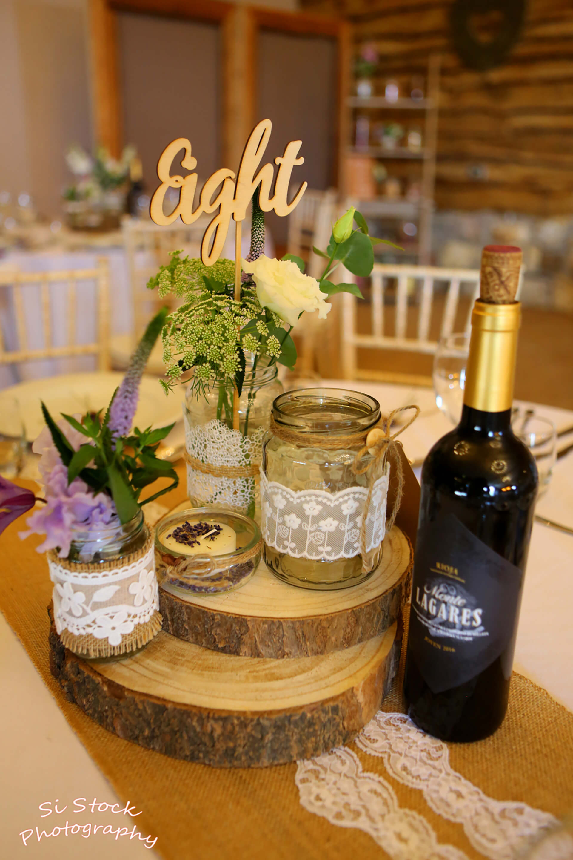 Aren't Katie and James' centerpieces just beautiful? Photo by Simon Stock.