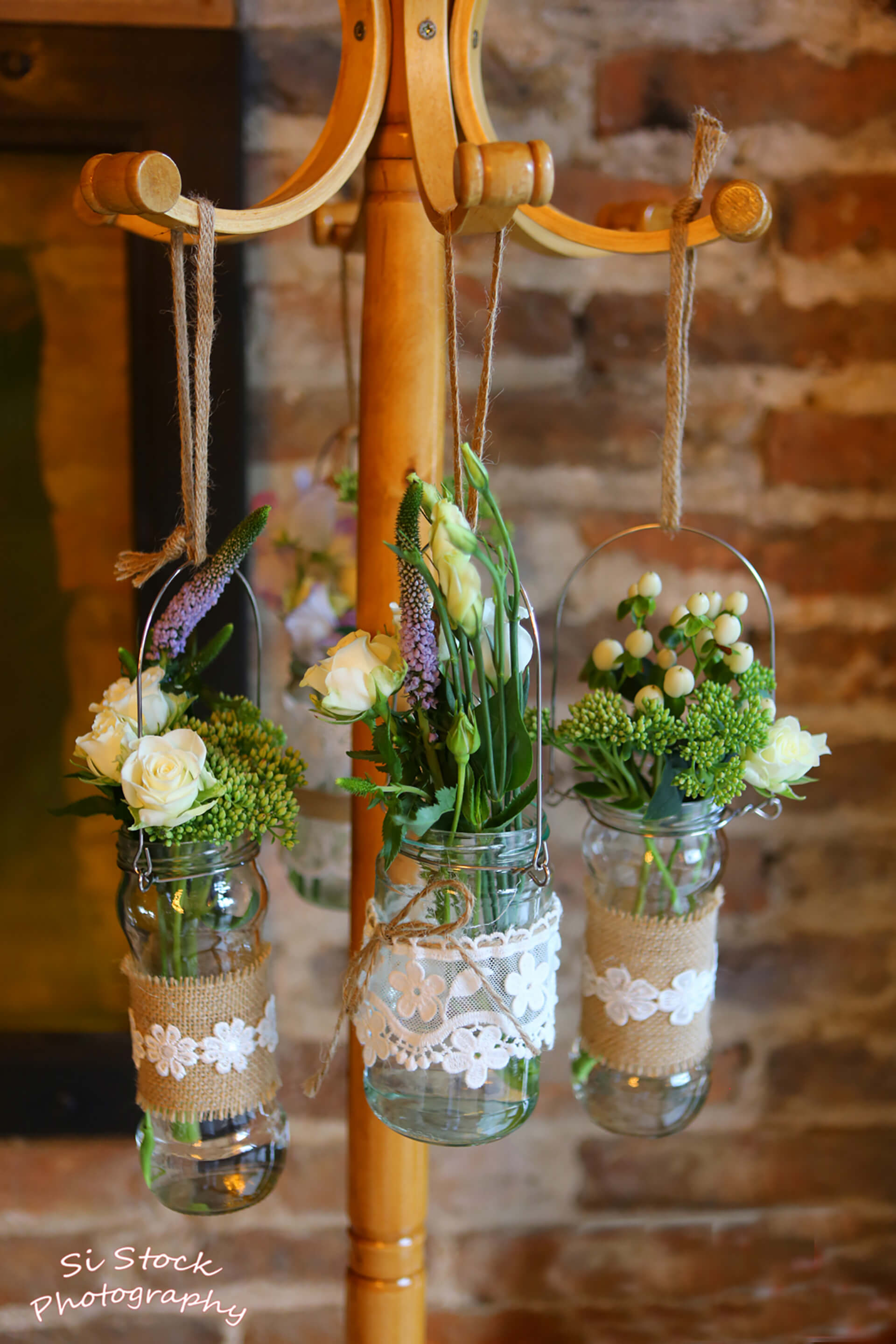 Katie and James' homemade hanging vases were so beautiful. Photo by Simon Stock.