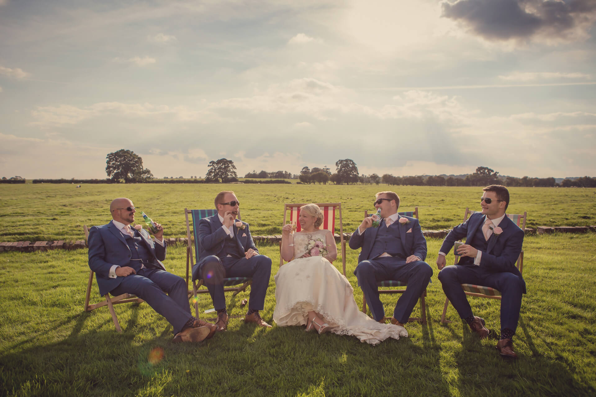 "Jo and Adam putting their feet up with their groomsmen! Photo by <a href=""http://www.lissaalexandraphotography.com/"" target=""_blank"">Lissa Alexandra Photography</a>."