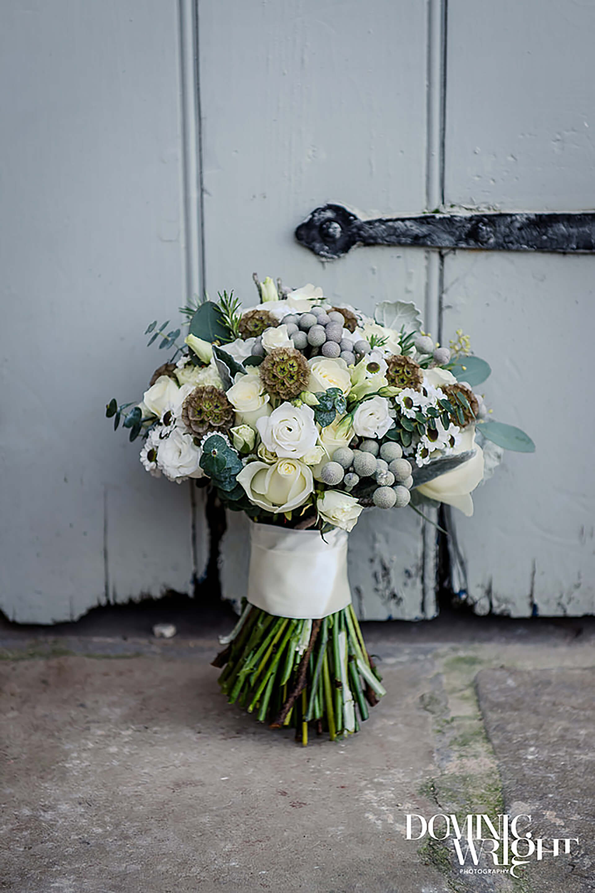 "Lucy's gorgrous winter bouquet. Photo by <a href=""http://www.dominicwright.co.uk/"" target=""_blank"">Dominic Wright Photography</a>"