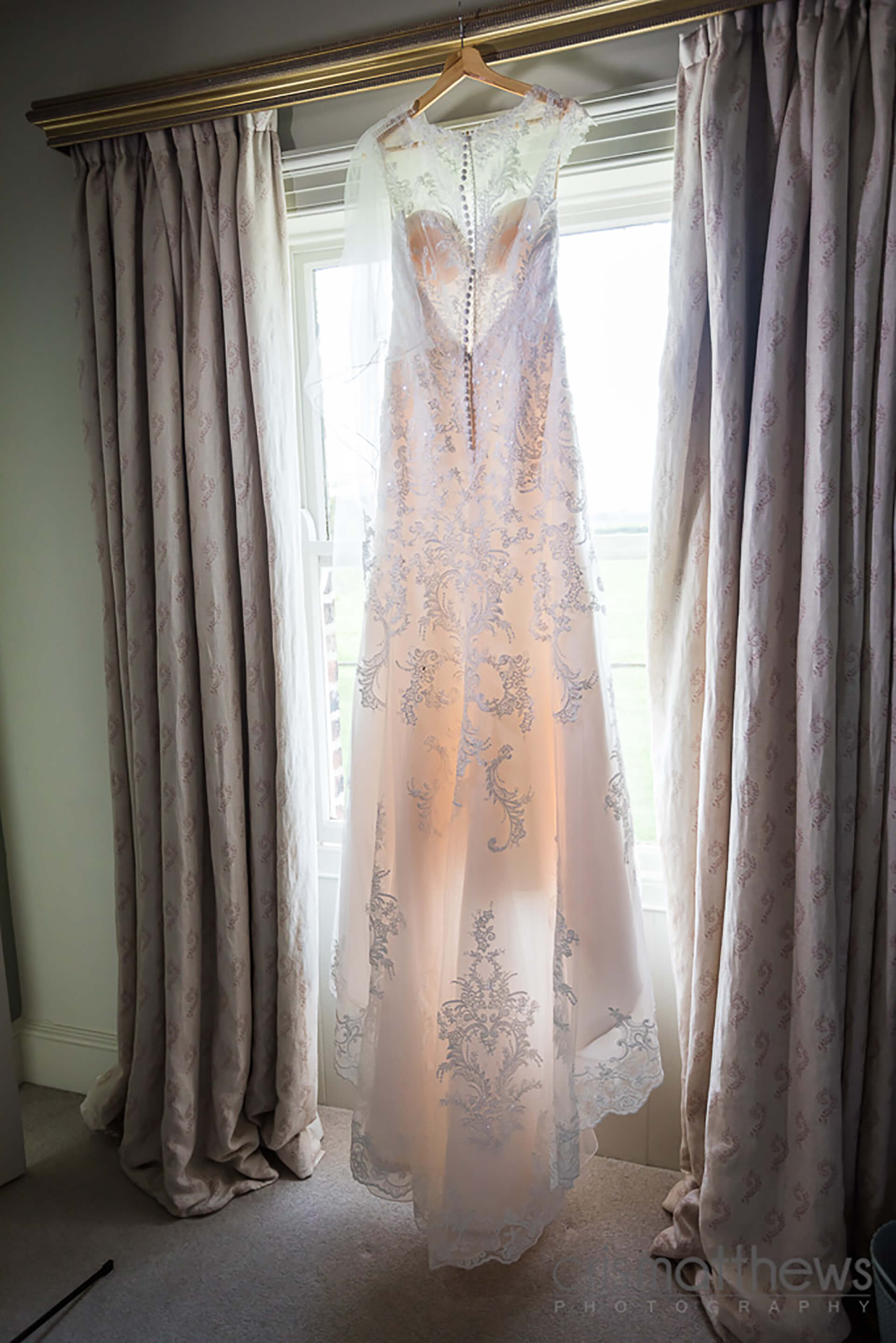 "Rachel's beautiful gown, captured by <a href=""http://www.crismatthews.com/"">Chris Matthews Photography</a>"