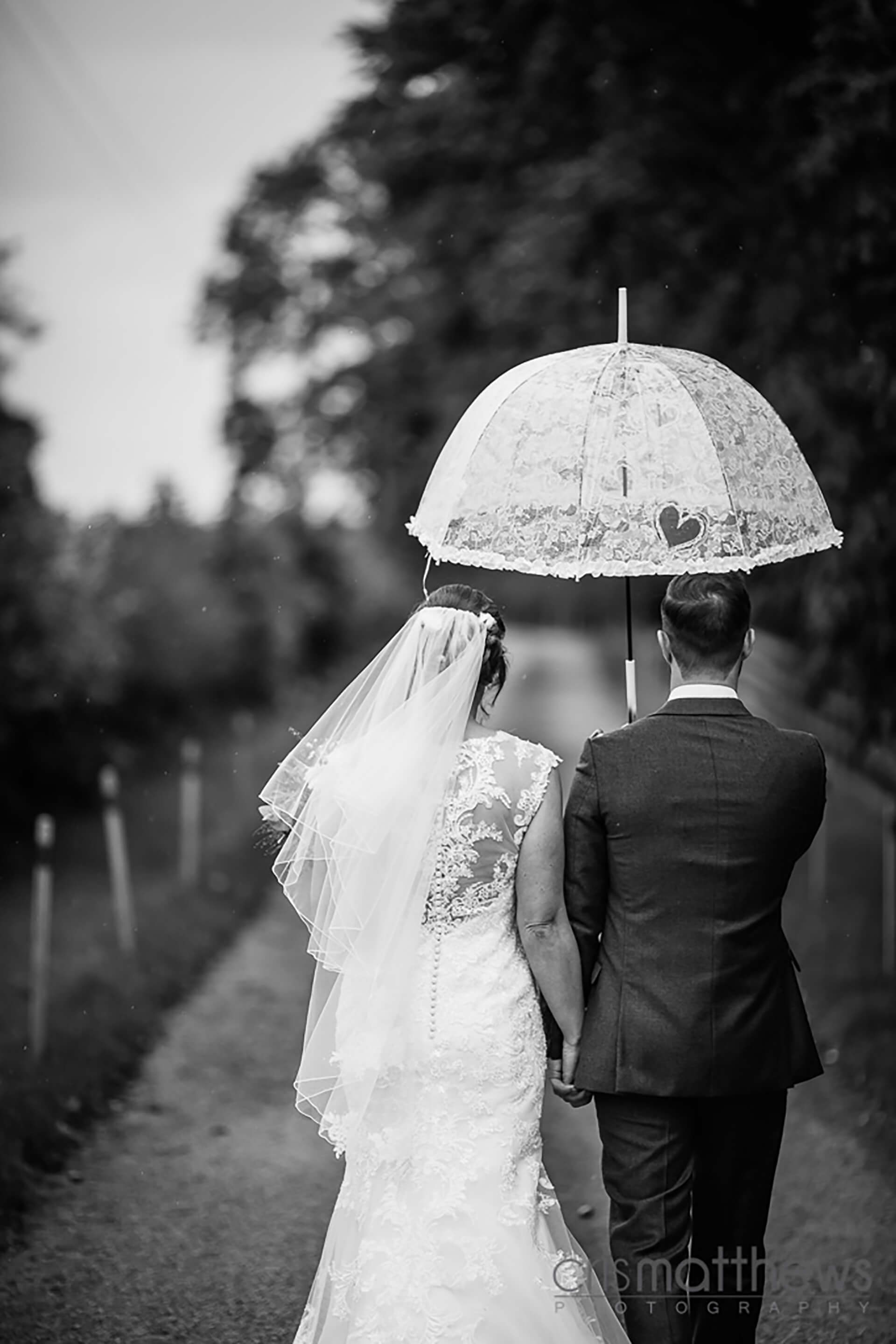 "Come Rain or Shine, Rachel and Dan captured by <a href=""http://www.crismatthews.com/"">Chris Matthews Photography</a>."