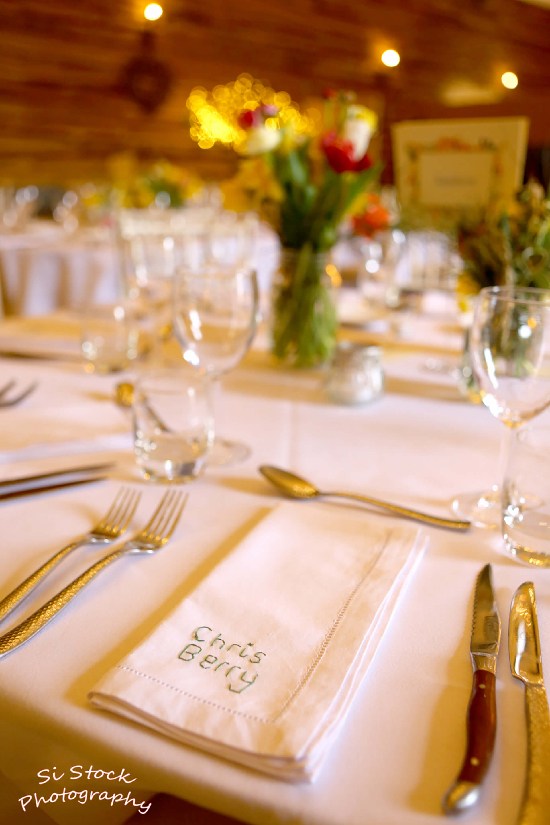 Katie and Stuarts's hand stitched place name napkins were a real labour of love! Photo by Simon Stock.