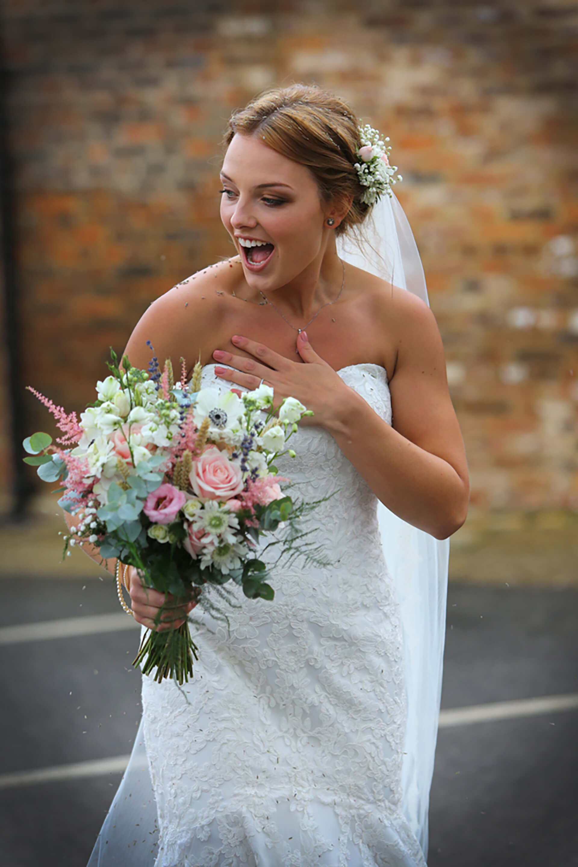 Our beautiful Tara with her stunning bouquet. Photo by Simon Stock.