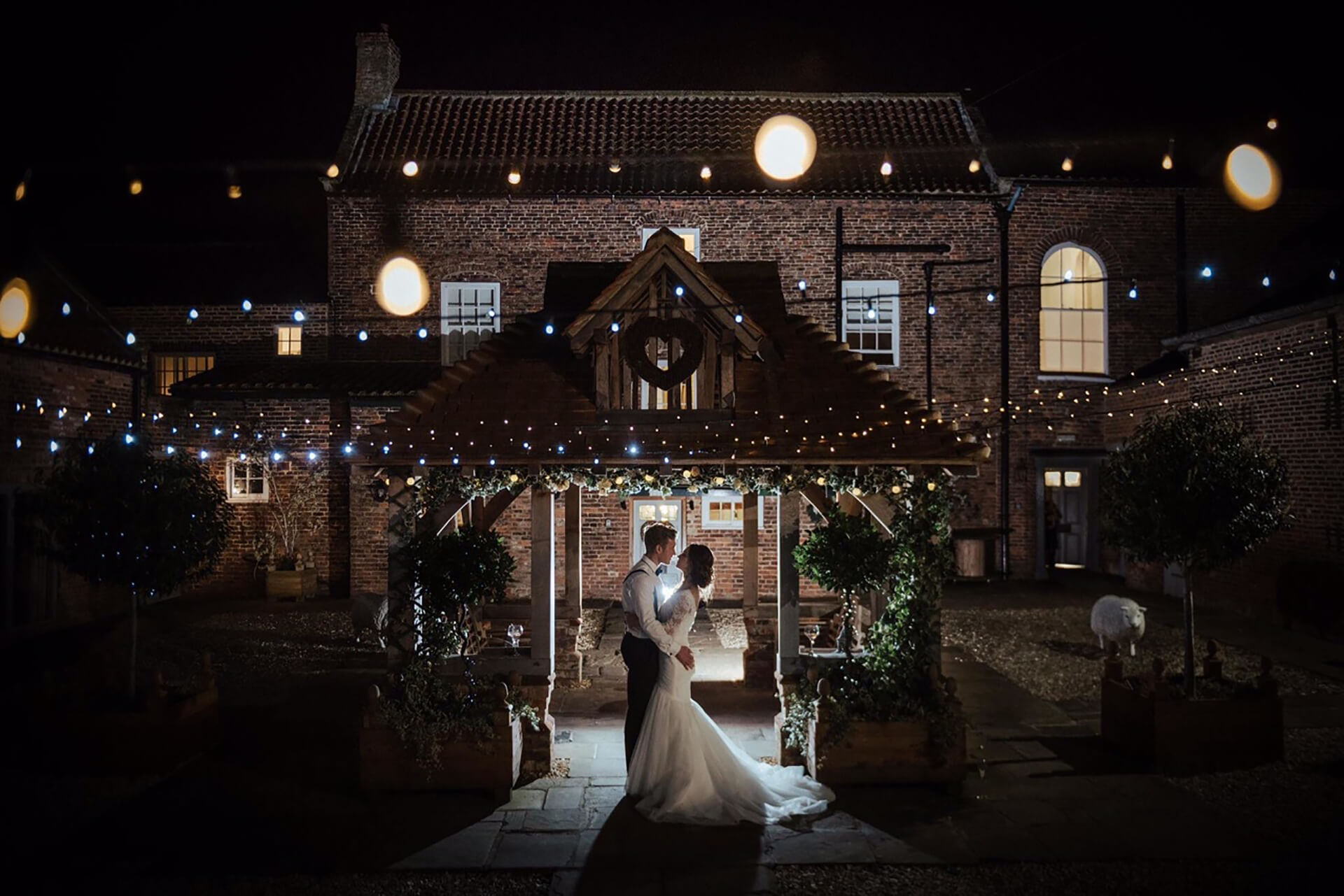 "The stunning Jade and Josh under the Lych Gate. Photo by <a href=""http://www.sugarbirdphoto.co.uk/"" target=""_blank"">Sugarbird Photography</a>"