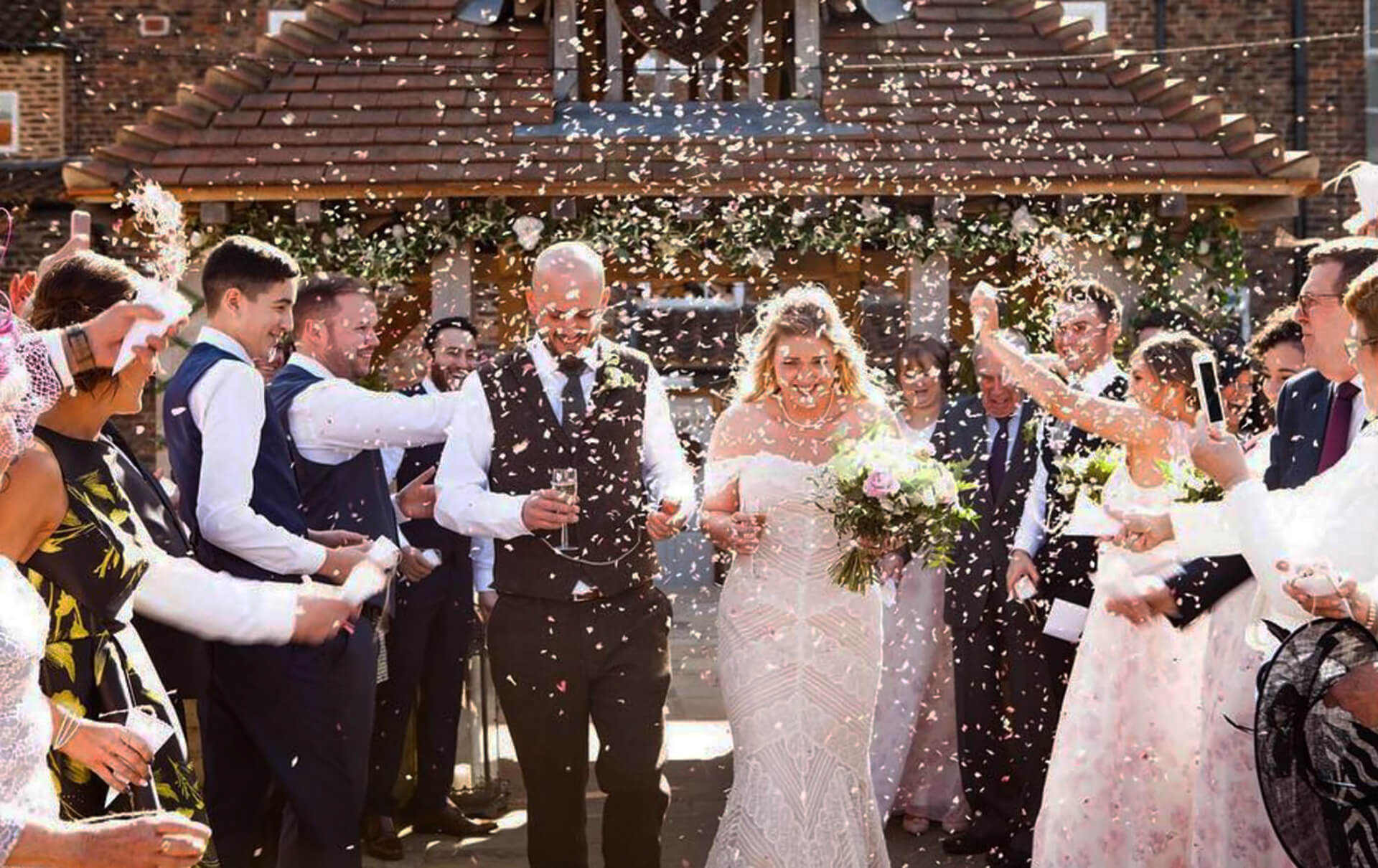 "Confetti showers for Liz and Jonny. this beautiful shot was captured by <a href=""https://www.vivienneedgephotography.co.uk/"" target=""_blank"">Vivienne Edge Photography</a>."
